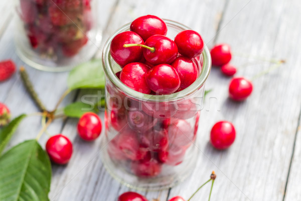 Glasses full freshly picked cherries raspberries Stock photo © fotoaloja