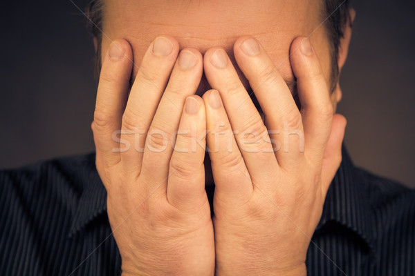 Crying white man hands face Stock photo © fotoaloja