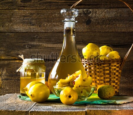 Stock photo: alcohol quince liqueur sliced fruit prepare wooden setting