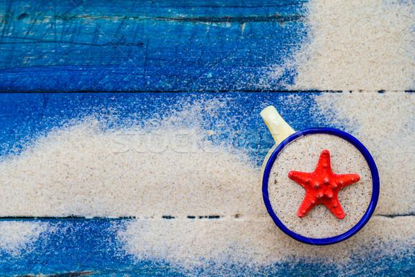 Shell Cup sabbia blu spiaggia acqua Foto d'archivio © fotoaloja