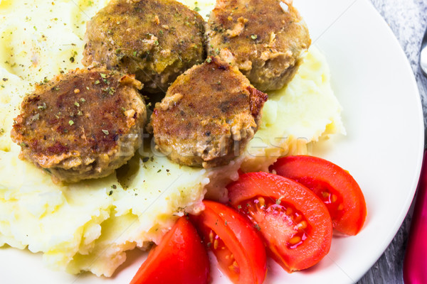 Stock photo: Fried pork chops boiled potatoes tomatoes