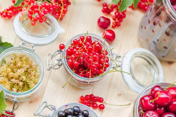 red white black currants gooseberries cherries jars preparations Stock photo © fotoaloja