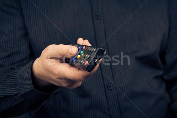 Man tv remote control hand Stock photo © fotoaloja