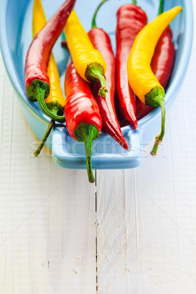 Színes paprikák kék tál tűz fa Stock fotó © fotoaloja