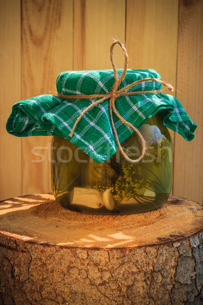 Jar pickled cucumbers wooden stump Stock photo © fotoaloja