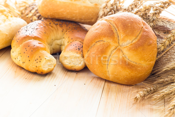 Various bakery products wooden background Stock photo © fotoaloja