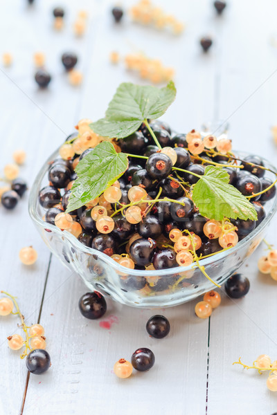 Fruits white black currants saucer wooden table Stock photo © fotoaloja