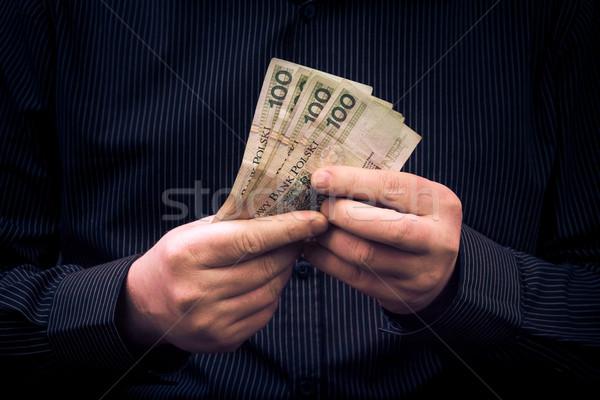 man holds hands Polish money Stock photo © fotoaloja