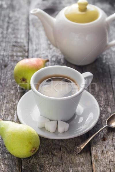 Kávéscsésze fekete fa deszka barna körték fehér Stock fotó © fotoaloja