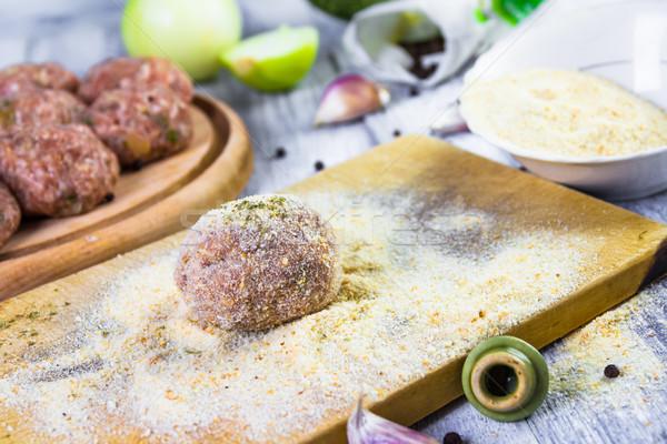 Stock photo: process rolling raw meatballs breadcrumbs