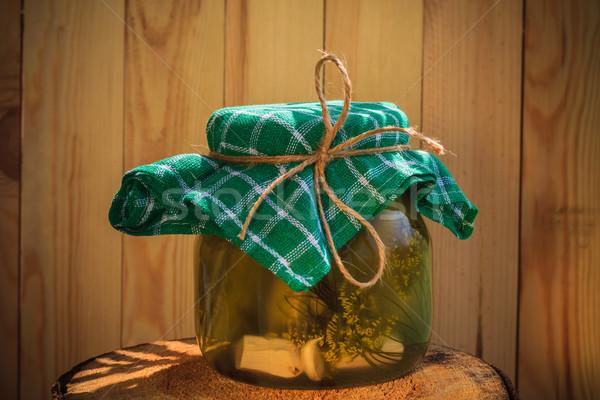 Jar pickled cucumbers wooden stump Stock photo © fotoaloja