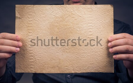 Old sheet paper hands vertically Stock photo © fotoaloja