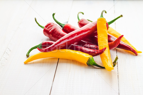 Red yellow chili peppers wooden background Stock photo © fotoaloja
