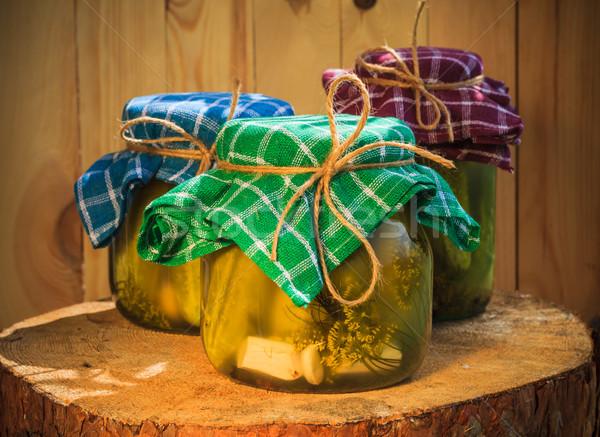 Jars pickled gherkins wooden table Stock photo © fotoaloja