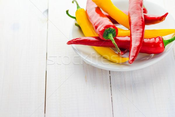 Piros citromsárga chilipaprika űr szöveg tűz Stock fotó © fotoaloja