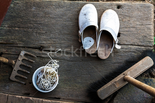 Clogs shoes boots broom string rake wooden porch schoes Stock photo © fotoaloja