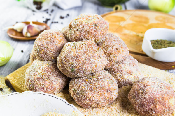Closeup meat balls ground beef rolled breadcrumbs Stock photo © fotoaloja