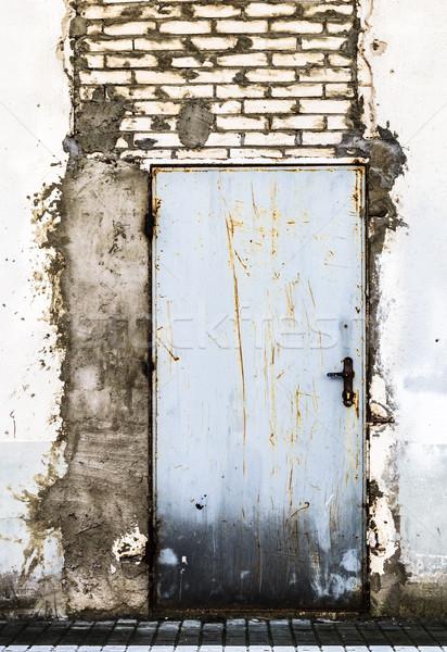 Ruined brick wall closed steel door Stock photo © fotoaloja