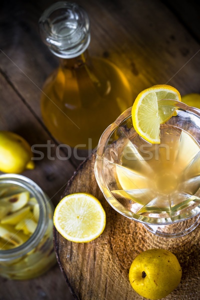 alcohol quince liqueur sliced fruit jar wooden cups Stock photo © fotoaloja