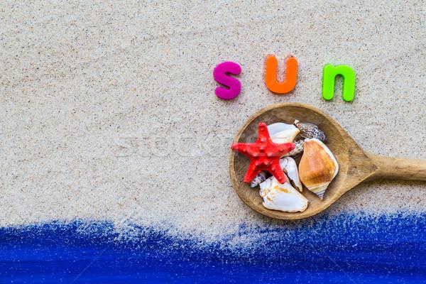 Stock photo: Word sun laid sand blue board
