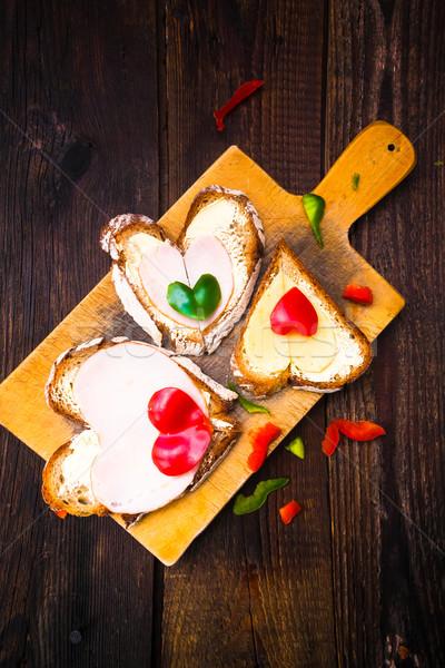 Valentin nap szendvicsek reggeli szerelmespár fából készült étel Stock fotó © fotoaloja