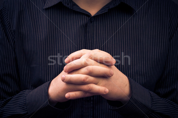 man wearing shirt folded hands Stock photo © fotoaloja