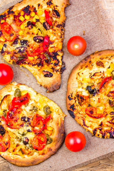 Close-up burnt pieces pizza Stock photo © fotoaloja