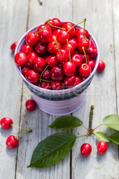 Fruit cherries bucket table Stock photo © fotoaloja