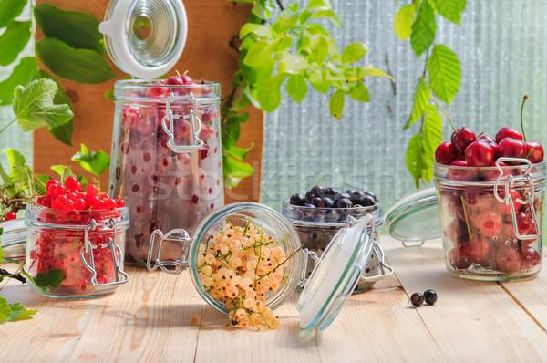 white black red currants gooseberries cherries jars preparations Stock photo © fotoaloja