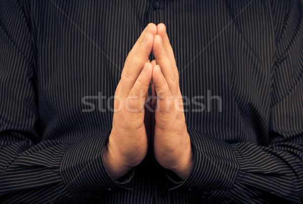 Closeup praying white man dark shirt Stock photo © fotoaloja