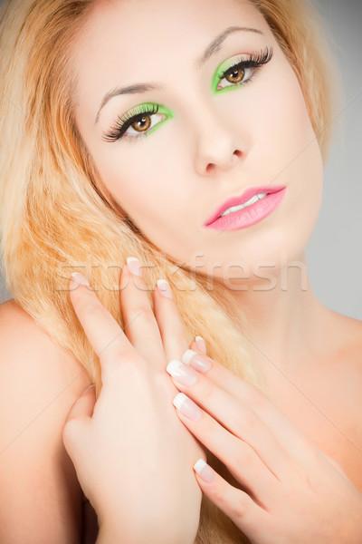 Mooie blond meisje kat ogen make Stockfoto © fotoduki