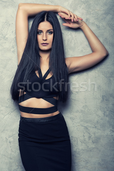 attractive young girl posing in black clothes Stock photo © fotoduki