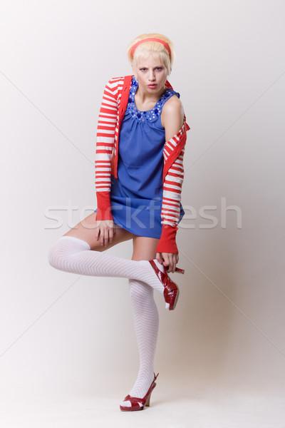 emotion pose blond girl in red woolly Stock photo © fotoduki
