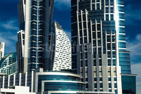 Magas épület felhőkarcoló kék homlokzat erkély Stock fotó © fotoduki