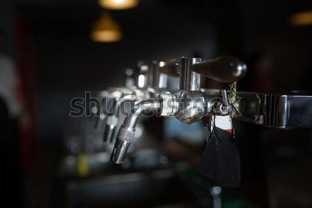 closeup beer cold tap in pub Stock photo © fotoduki