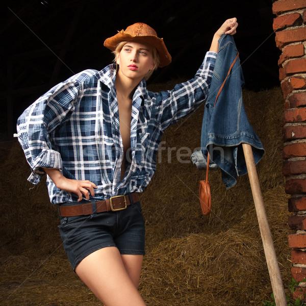 Atraente vaqueiro menina aldeia mulher parede Foto stock © fotoduki