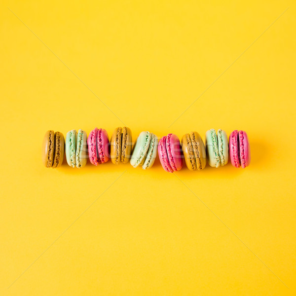 colorful macarons on yellow background Stock photo © fotoduki