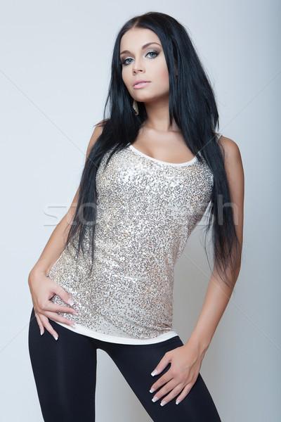 Aantrekkelijk brunette jong meisje mode stijl grijs Stockfoto © fotoduki