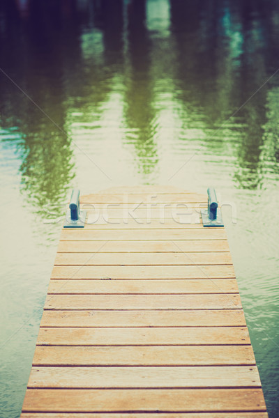 Wooden wharf and blue water Stock photo © fotoduki