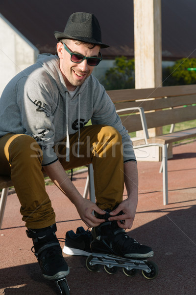 Man tying skates Stock photo © fotoedu