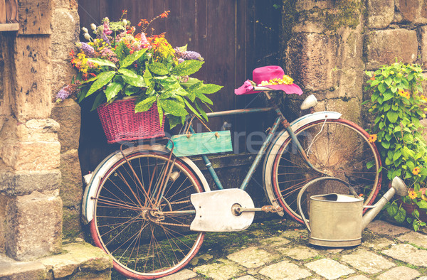 Old bicycle with flowers Stock photo © fotoedu