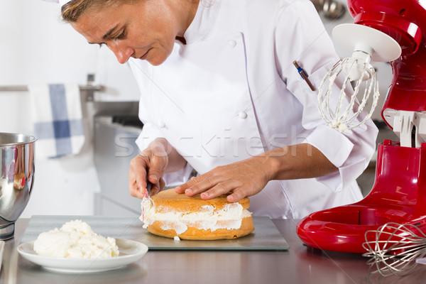 Chef decorating cream Stock photo © fotoedu
