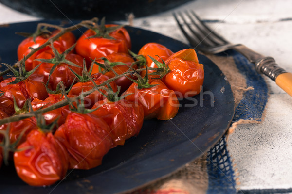 Baked cherry tomatoes Stock photo © fotoedu