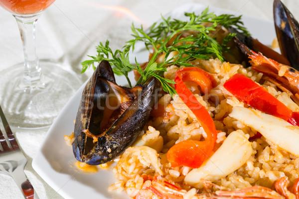 Lezzetli deniz ürünleri pirinç karides turuncu domates Stok fotoğraf © fotoedu