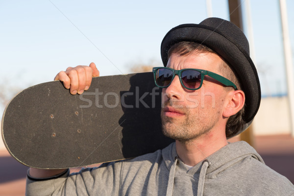 Serious man with his skateboard Stock photo © fotoedu