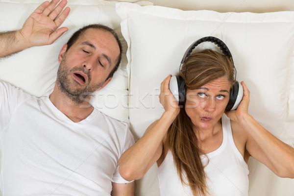 Boldog nő konzerv alszik most fejhallgató Stock fotó © fotoedu