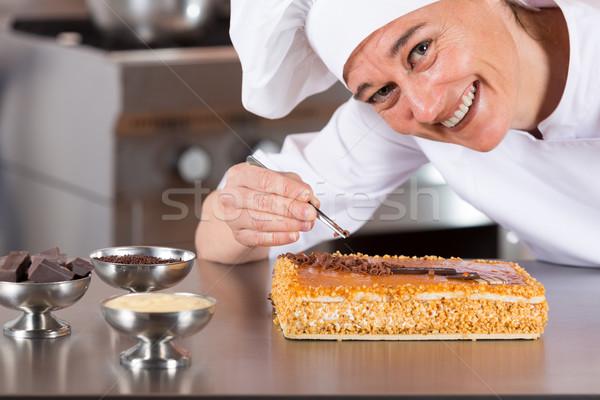 Pastry chef decorating Stock photo © fotoedu