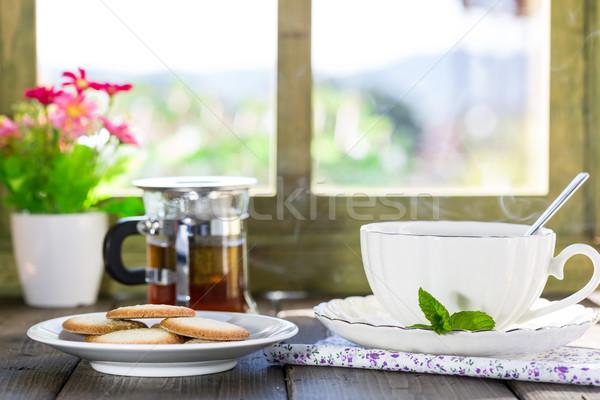 Copo quente chá delicioso bolinhos Foto stock © fotoedu