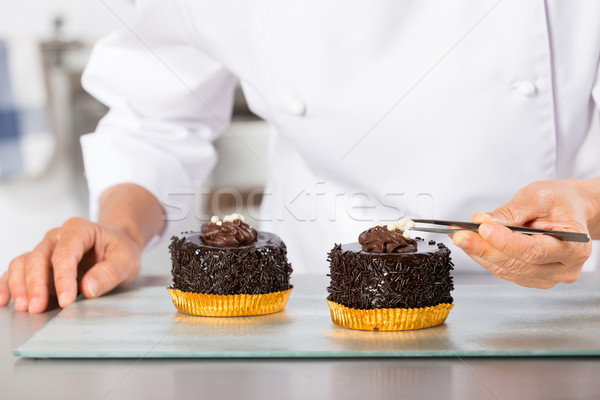 Chef finishing a cake Stock photo © fotoedu