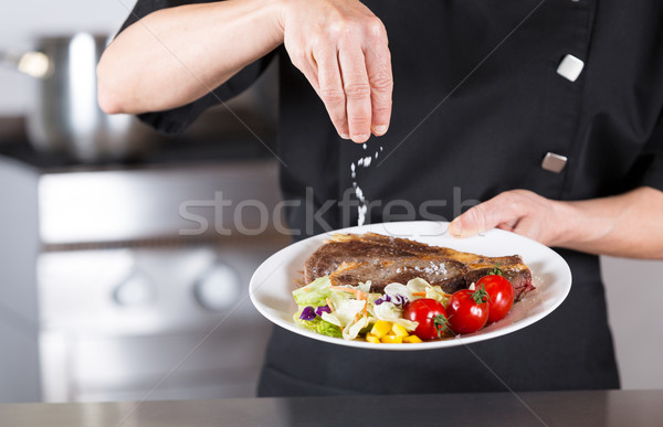 Chef finishing your plate Stock photo © fotoedu